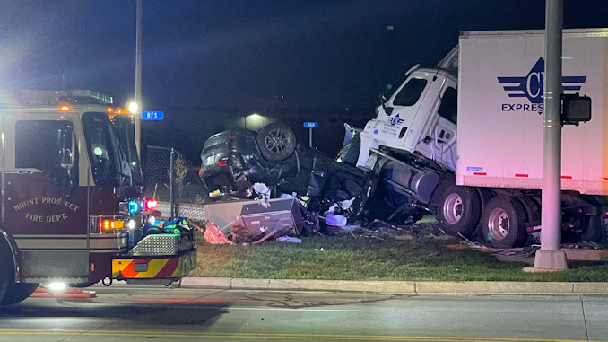 Semi-tractor on top of rolled over Jeep SUV at Dempster Street and Linneman Road in Mount Prospect.