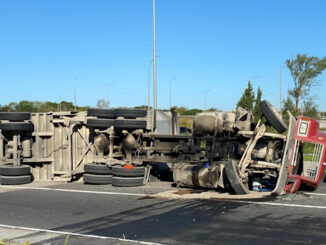 Underside of a rolled over semi-trailer dump truck in the eastbound lanes of Palatine Road just east of Route 53